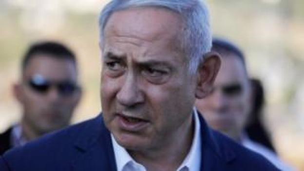Israel's Prime Minister Benjamin Netanyahu speaks to the press at the site where an off-duty Israeli soldier was found dead