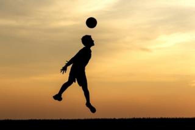 Child heading football