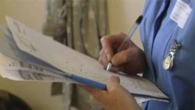 A nurse taking notes