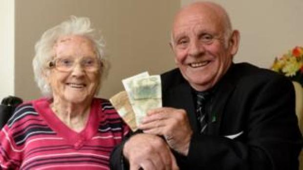 Michael Doherty and his mother Margaret with his pay packet
