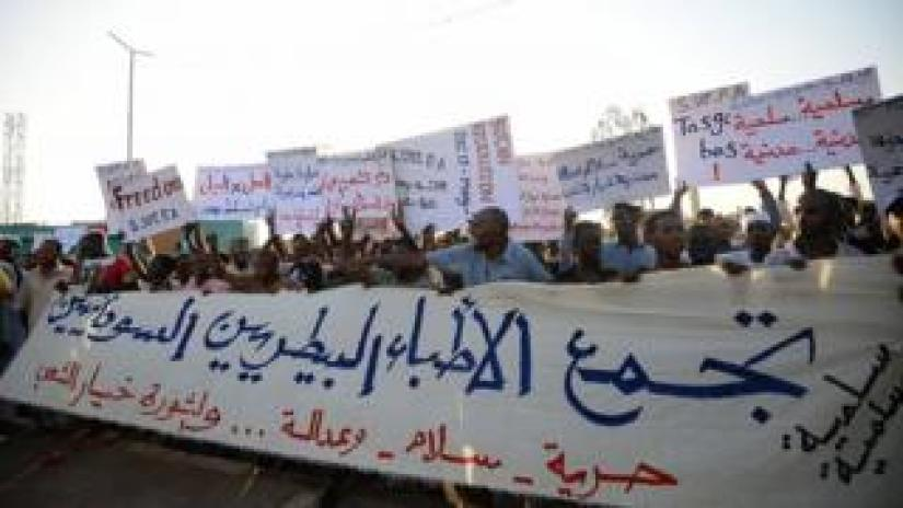 Sudanese protesters chant slogans and wave placards during a demonstration in Khartoum on May 14, 2019