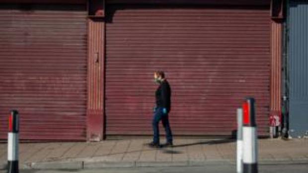 Woman walking through Cardiff street