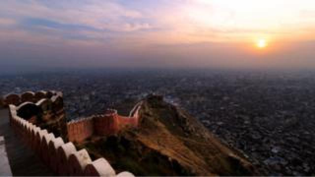 A view of Walled city of Jaipur from the Nahargarh Fort hills during the last Sunset of the year 2015 in Jaipur, India , 31 Dec ,2015.