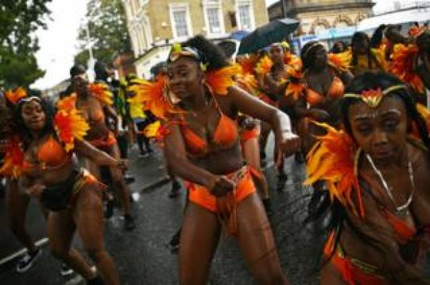 Performers take part in the Notting Hill Carnival family day.