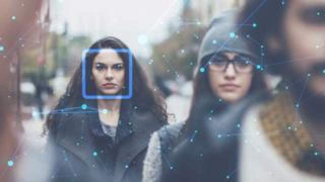 Woman with facial recognition marks