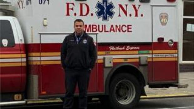 Anthony Almojera in front of his ambulance