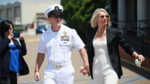Navy Special Operations Chief Edward Gallagher walks out of military court with his wife Andrea Gallagher.