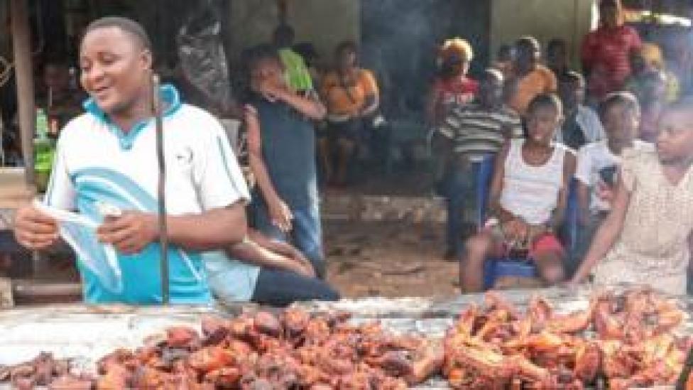 Man selling chicken in a street of Arondizuogu during the Ikeji Festival in Nigeria