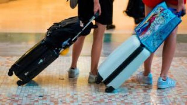 Holidaymakers with baggage