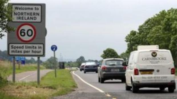 Vehicles travel on a road over the Irish border