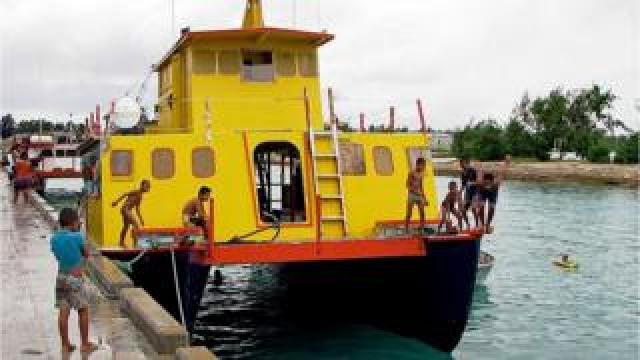 The MV Butiraoi, a wooden catamaran