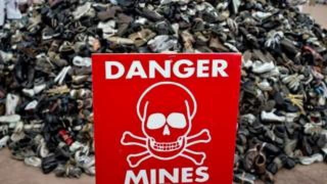 A sign during the annual demonstration by the NGO Handicap International to denounce the use and sale of anti-personnel landmines