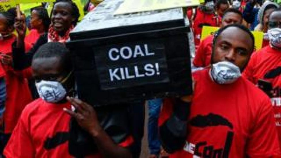 Protesters carrying a coffin which says 'coal kills'.