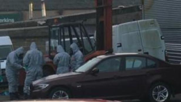 BMW car and police in chemical suits