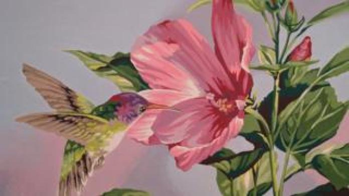 Image of a hummingbird near a flower