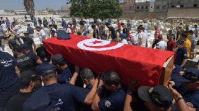 Police officers carry the coffin of a fellow officer, who was killed in yesterday's suicide attack on Habib Bourguiba avenue, during his funeral in the Sidi Hassine western suburb of the capital Tunis on June 28, 2019. - Two blasts claimed by the Islamic State group killed a police officer in Tunis and wounded several other people on June 27, 2019.