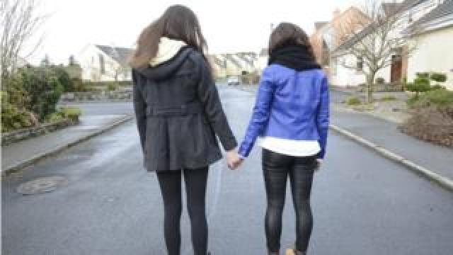 teenage girls holding hands