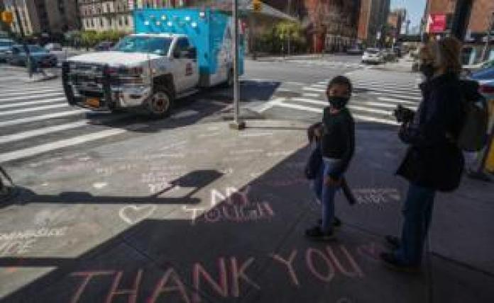 Thank you messages are written on the sidewalk outside of Mt. West Sinai Medical Center