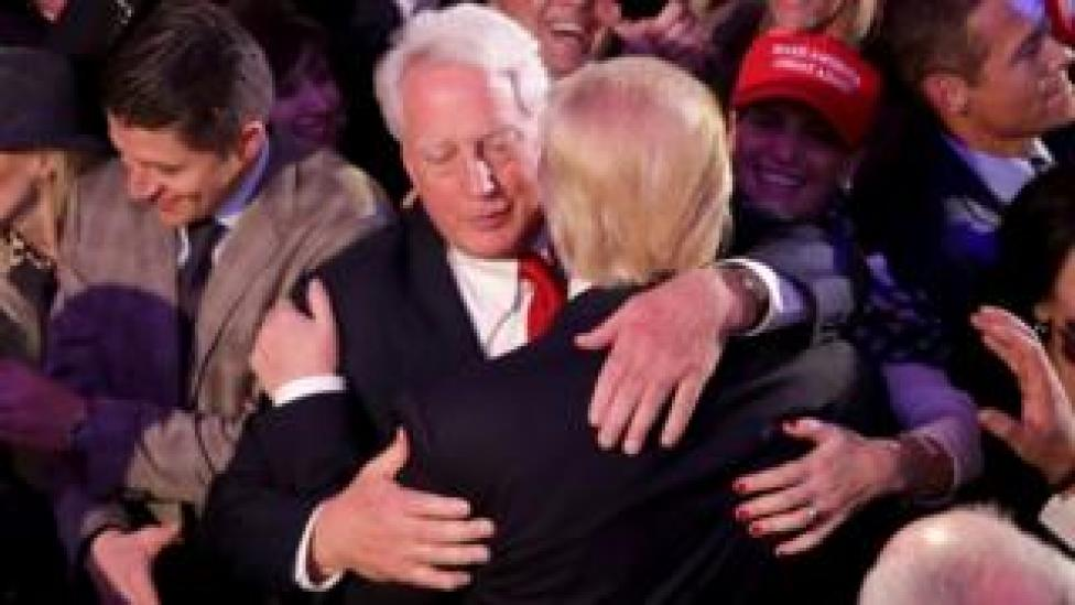 Robert and Donald Trump embrace following the 2016 election