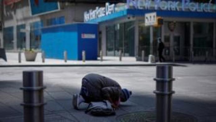 Muslim woman prays in Times Square - April 7