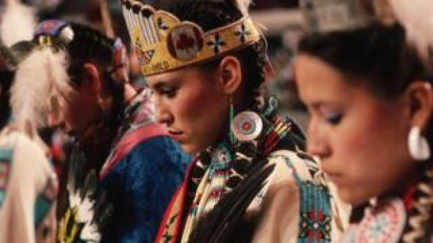 An American Indian dance group prepares to perform at a Native American gathering in Oklahoma City