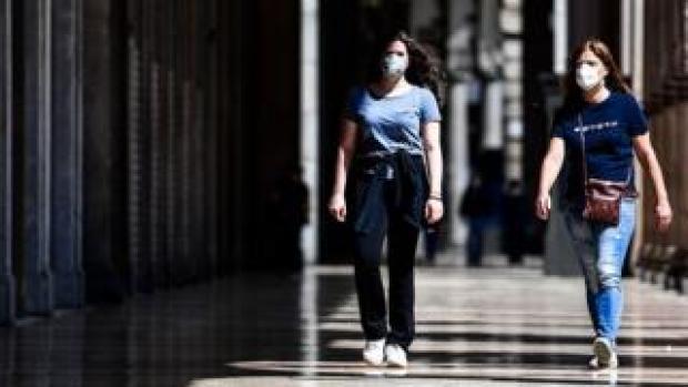 Woman walk in shopping arcade in Milan