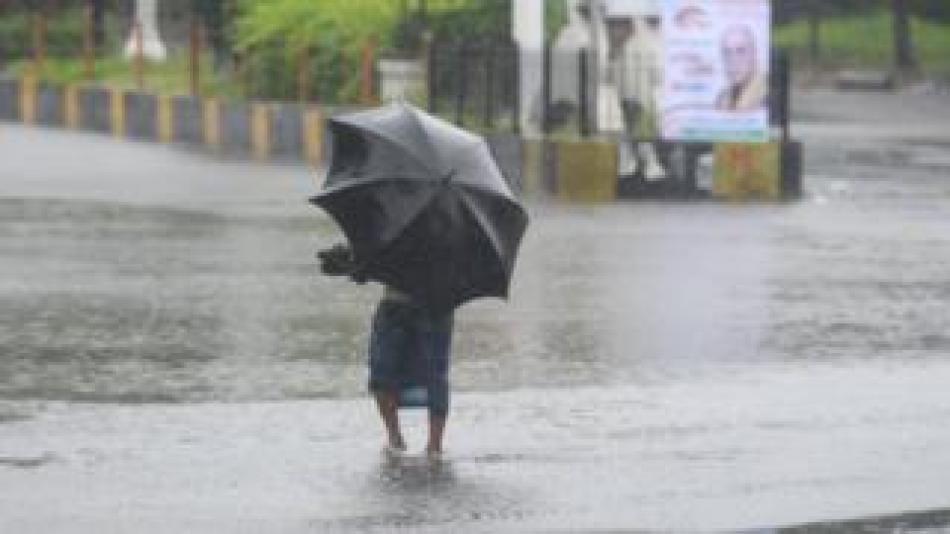 Eccd.net News  A man with an umbrella wades through floodwater in Khulna, Bangladesh