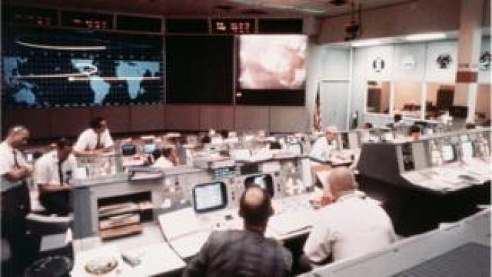Mission Operations Control Room in the Mission Control Center, Building 30, on the second day of the Apollo II lunar landing mission