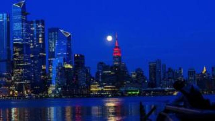 Supermoon rises behind Empire State Building - April 7, 2020