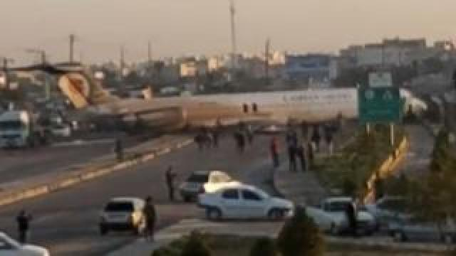 The aircraft stands on a road after skidding off the runway at Mahshahr airport