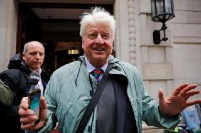 Stanley Johnson, father of Britain's Prime Minister Boris Johnson, leaves the Millbank broadcast studios near the Houses of Parliament on September 24, 2019