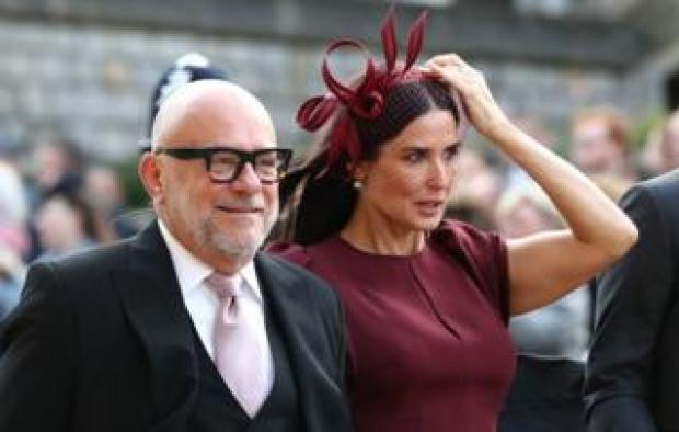 """Demi Moore (right) arrives ahead of the wedding of Princess Eugenie to Jack Brooksbank at St George""""s Chapel in Windsor Castle"""