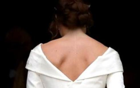 Princess Eugenie shown in her wedding dress from the back
