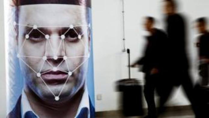 A poster simulating facial recognition software at the Security China 2018 exhibition in Beijing, October 24, 2018