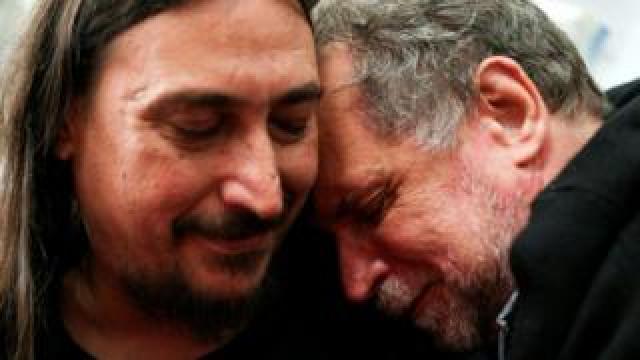 Javier Darroux Mijalchuk, left, embraces his uncle Roberto