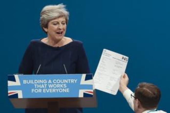 Prime minister Theresa May is handed a P45