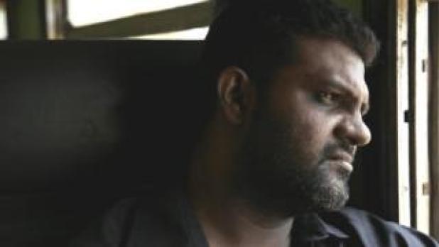 Filmmaker Jude Ratnam on a train in Sri Lanka