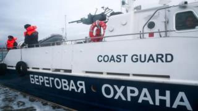 A file picture of Russian coast guards on a boat