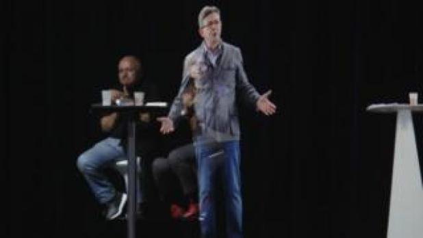 French presidential election candidate Jean-Luc Melenchon delivers a speech via hologram