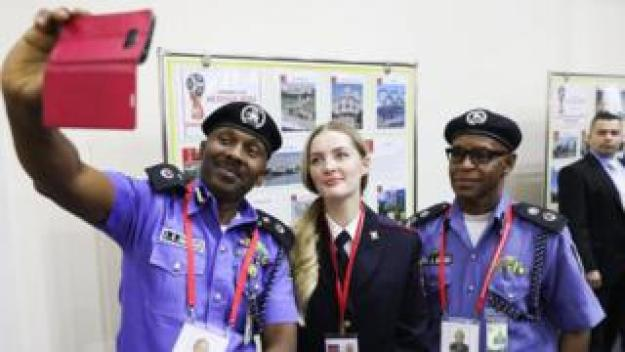 Nigeria's and Russia's law enforcement officers take a selfie at the opening of the Centre for International Police Cooperation; the Centre is to be in operation during the 2018 FIFA World Cup.