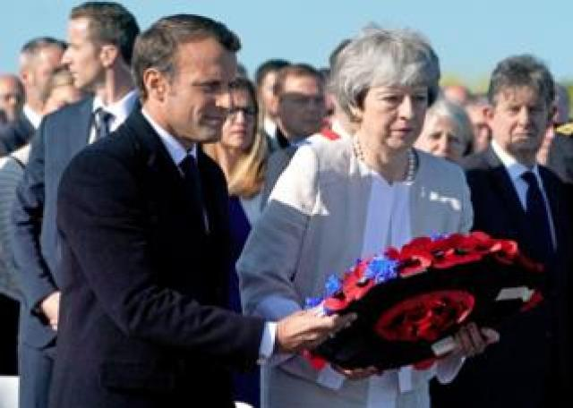 Mrs May and Mr Macron then lay a wreath together