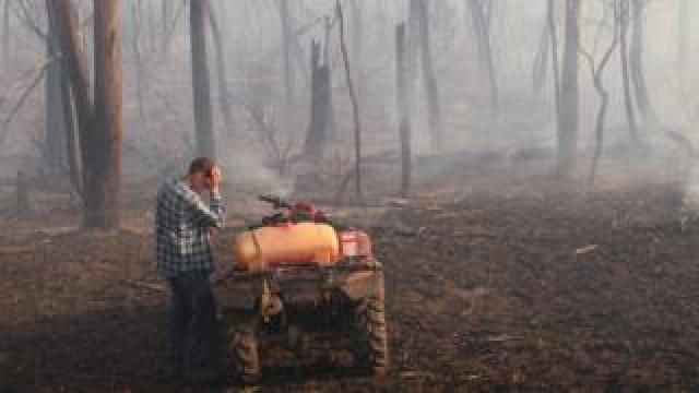 A farmer struggles with the conditions on his property near Labertouche, Victoria