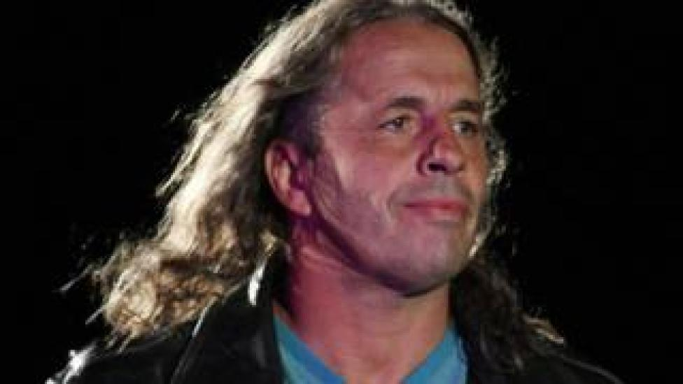 Bret Hart acting as referee in the ring at a wrestling event in 2011