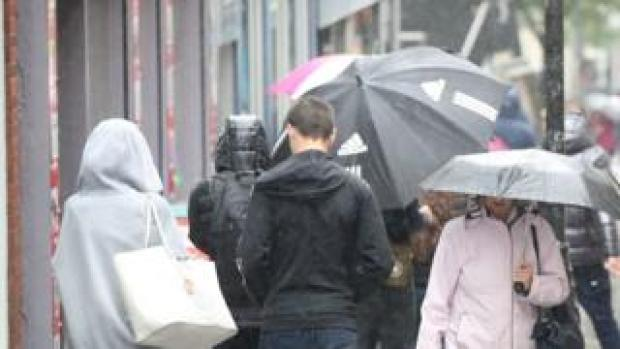 People with umbrella in Nottingham on 3 October 2020