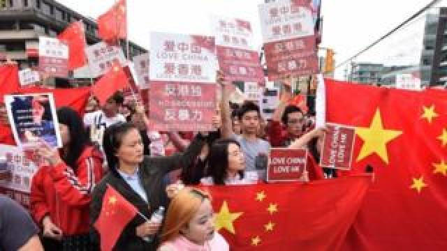 Pro-Chinese government supporters protest in Vancouver