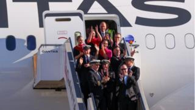 Qantas Group CEO Alan Joyce and crew after arriving at Sydney airport after completing a non-stop test flight from New York