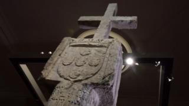 The Stone Cross on display in a Berlin museum