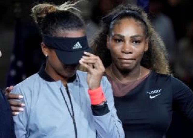 Naomi Osaka and Serena Williams at the trophy ceremony of the 2018 US Open tennis tournament