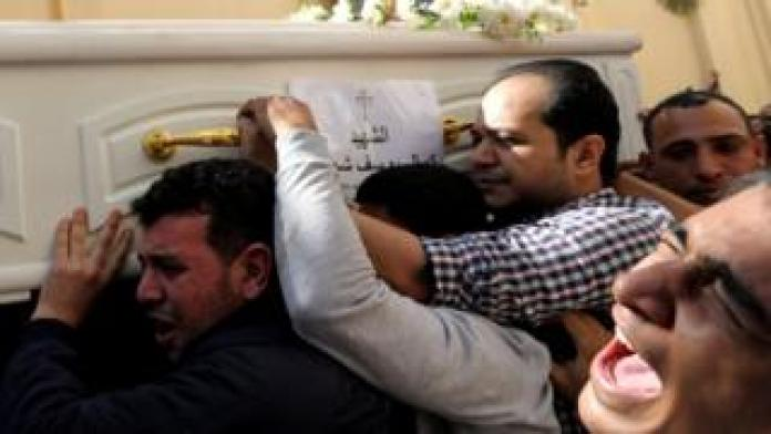 Mourners carry a coffin during the funeral of Coptic Christians who were killed in an attack on November 3, 2018 in Minya, Egypt