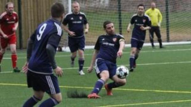 Rob McPherson playing for the Village Manchester football team